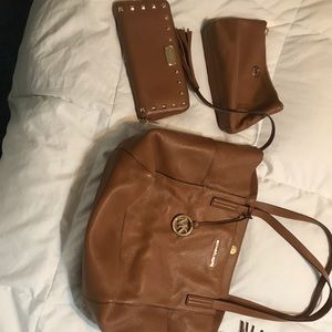 Michael Kors tote, matching wallet, and makeup bag